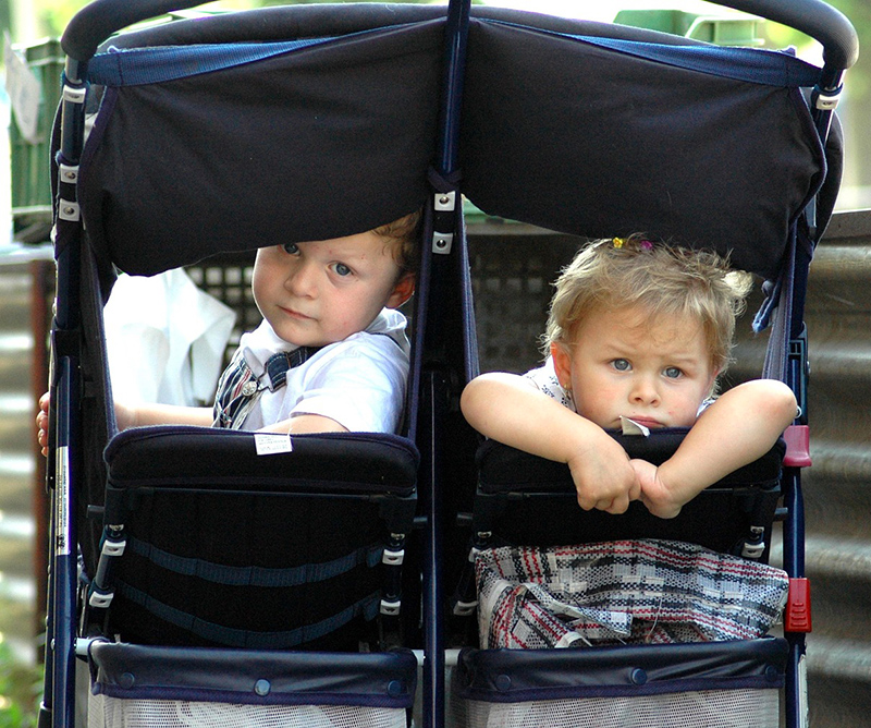 kids in a double stroller